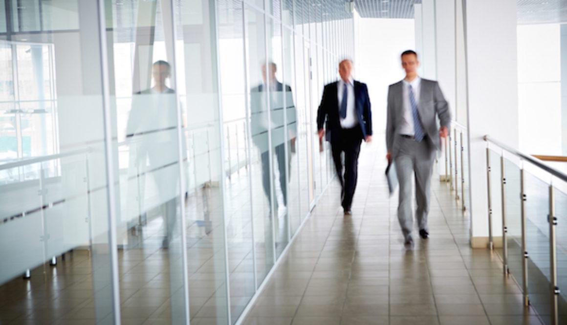 Businessmen walking suits 600x400pxl